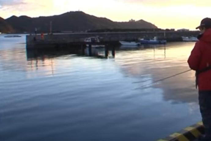 釣り人 漁港 写真