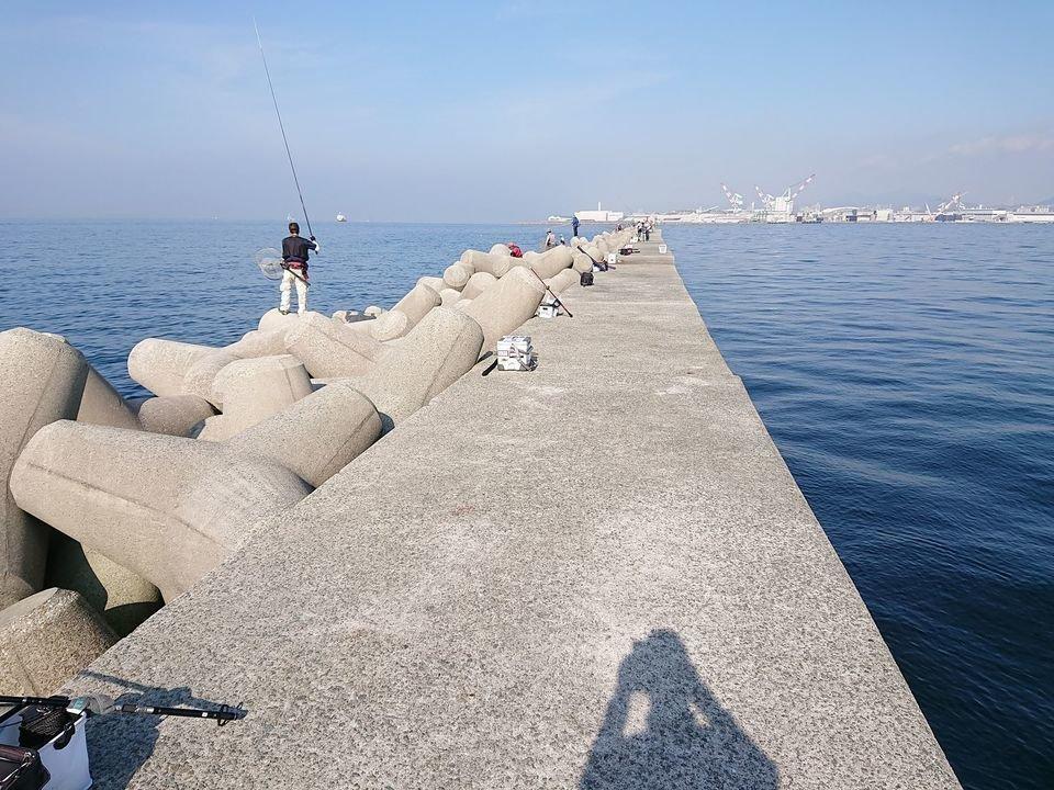 堤防 釣り人 写真