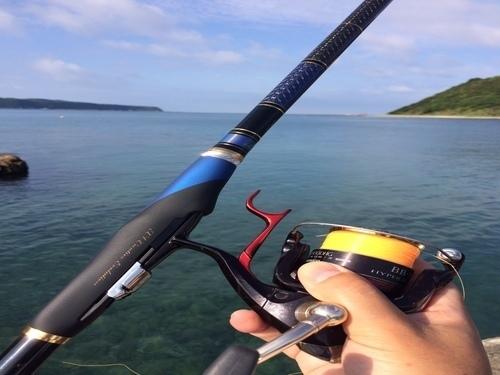釣り竿 ロッド 手 海 写真