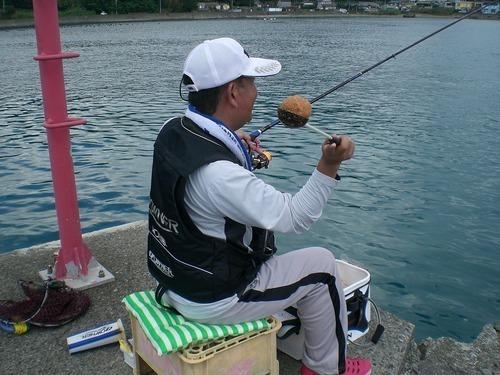 釣り竿 ダンゴ 男性 海 写真