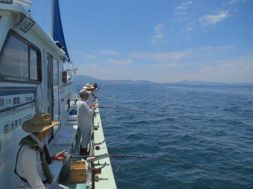 釣り人 釣り船 海 写真