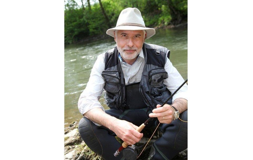男性 釣り人 釣り竿 写真