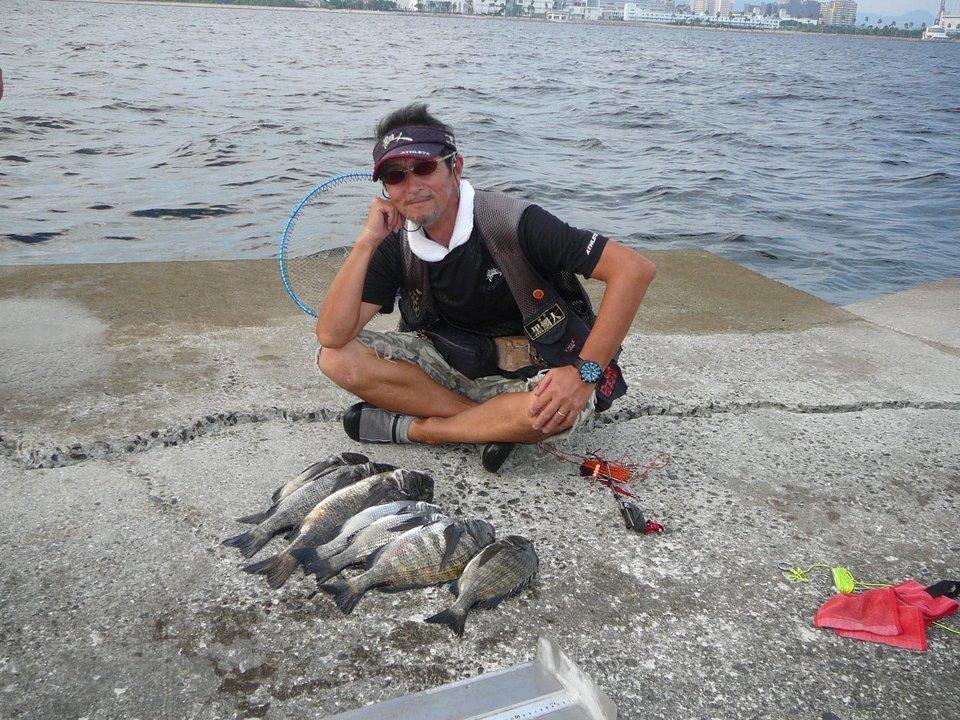 釣り人 クロダイ 海 写真