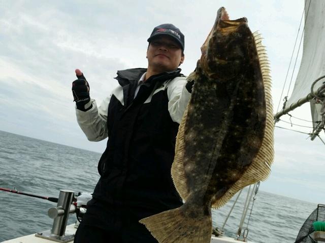 釣り人 ヒラメ 写真